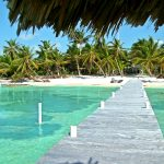 Experience private white sand beach and private pier and warm Caribbean waters