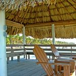 Relax under the natural woven roof of the Escape Away Palapa
